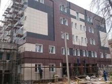 Реконструкция незавершенного строительством здания в жилой дом с нежилыми помещениями, расположенными в уровне 1 и 2 этажей